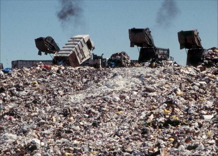 landfill trucks dumping